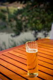Beer. A glass of beer, taken in restaurant with table outdoors Stock Photo