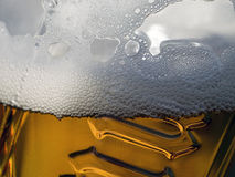 Beer. A gold beer background macro royalty free stock images