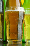 Beer. Green both brown bottles and glasses of beer Stock Images