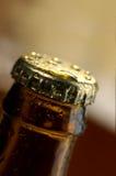 Beer. Brown bottle of beer on a black background Stock Image