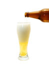 Beer. Effuse beer in a glass Royalty Free Stock Image