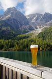 Beer in Alpine scenery. Relaxing and having a beer in Alpine scenery royalty free stock image
