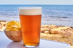 Free Beer And Chips In The Beach Stock Photo - 121521890