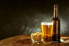 Free Beer And Peanuts On An Old Wooden Bar Table Stock Images - 71363934
