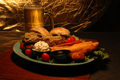Beer and appetizer platter. Mini burgers, taquito's, and Jalepeno poppers royalty free stock photo