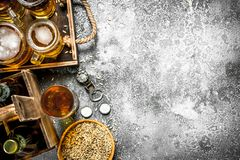Beer background. Fresh beer with ingredients. On a rustic background Royalty Free Stock Image