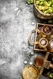 Beer background. Fresh beer with ingredients. On a rustic background Stock Images