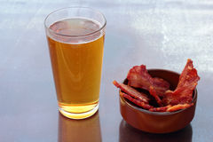 Beer and bacon. Stock Photos
