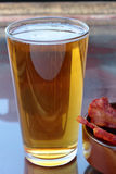 Beer and bacon. Stock Photography