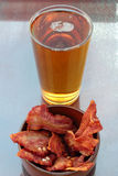 Beer and bacon. Royalty Free Stock Image