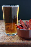 Beer and bacon. Stock Photo