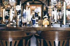 Beer bar pub. Long table with chairs Royalty Free Stock Photos