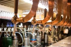 Beer bar pub tap, counter with blur pub background. Brussel Belgium.  Royalty Free Stock Photography