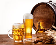 Beer barrel with beer glasses. On a wooden table. Isolated on a white background stock photography