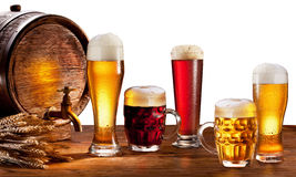Beer barrel with beer glasses. Beer barrel with beer glasses on a wooden table. Isolated on a white background. This file contains clipping path stock photography