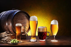 Beer barrel with beer glasses on a wooden table. Stock Images
