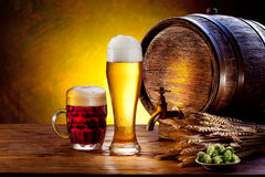 Beer barrel with beer glasses on a wooden table. Stock Image