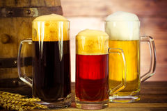 Beer barrel with beer glasses. On a wooden table stock photo