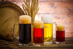Beer barrel with beer glasses. On a wooden table royalty free stock photos