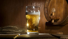 Beer barrel with beer mug on wooden background Royalty Free Stock Images