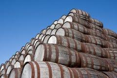 Beer Barrels. A stack of older beer barrels resting on top of each other Stock Photography
