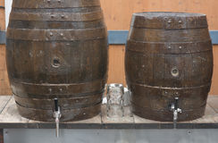 Beer Barrels and Glass Royalty Free Stock Images