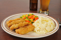 Beer battered chicken strips Royalty Free Stock Images