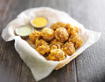 Beer battered mushrooms Stock Photo