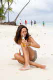 Beer on beach Royalty Free Stock Photography