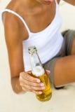 Beer on beach Stock Image