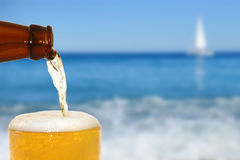 Beer. On the beach background Royalty Free Stock Images