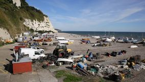 Beer beach Devon England UK with boats and fishing equipment on the Jurassic Coast stock footage