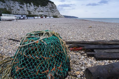 Beer Beach with Lobster Pot in foreground. Pebbled beach with Lobster Pot at Beer, Devon, England, United Kingdom Royalty Free Stock Image