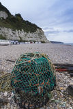 Beer Beach with Lobster Pot in foreground. Pebbled beach with Lobster Pot at Beer, Devon, England, United Kingdom Royalty Free Stock Photo