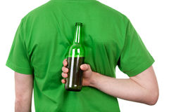 Beer behind back stock image