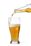 Beer being pour on a glass Royalty Free Stock Photo