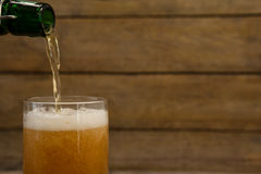 Beer being poured into a glass Royalty Free Stock Photos