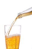 Beer being poured into a pilsner glass. Vertical image of beer being poured into a pilsner glass on white Royalty Free Stock Images