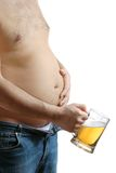 Beer belly. Fat man holding his beer belly Stock Images
