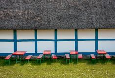 Beer benches and tables. In front of a guesthouse royalty free stock images