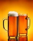 Beer beverage on yellow background Stock Photo