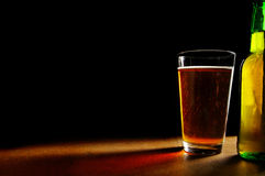 Beer on black Royalty Free Stock Image
