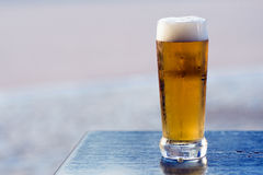 Beer on blue table Royalty Free Stock Photos