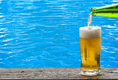 Beer with blue water ripple. Royalty Free Stock Photography