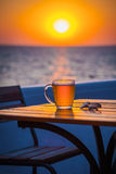 Beer with bokeh in the sea. Cold Draught Beer with bokeh of the sunset in the sea background Stock Photo
