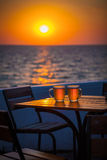 Beer with bokeh in the sea. Cold Draught Beer with bokeh of the sunset in the sea background Royalty Free Stock Photo