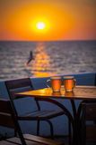 Beer with bokeh in the sea. Cold Draught Beer with bokeh of the sunset in the sea background Royalty Free Stock Image