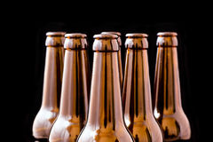 Beer bottle. An open beer bottle, black background isolated royalty free stock photography