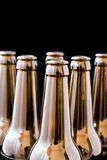 Beer bottle. An open beer bottle, black background isolated Royalty Free Stock Photos