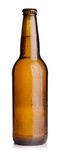 Beer bottle. Chilled brown beer bottle with water drops Royalty Free Stock Images